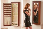 The 45-inch Wall Mounted Lighted Jewelry Armoire Organizes Your Jewelry in One Cool Display